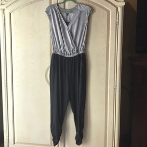 Guess black and white stripped jumpsuit.
